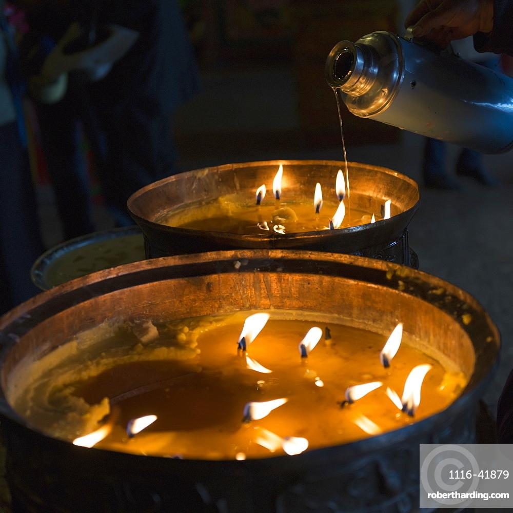 Candles burning in drepung monastery, Lhasa xizang china