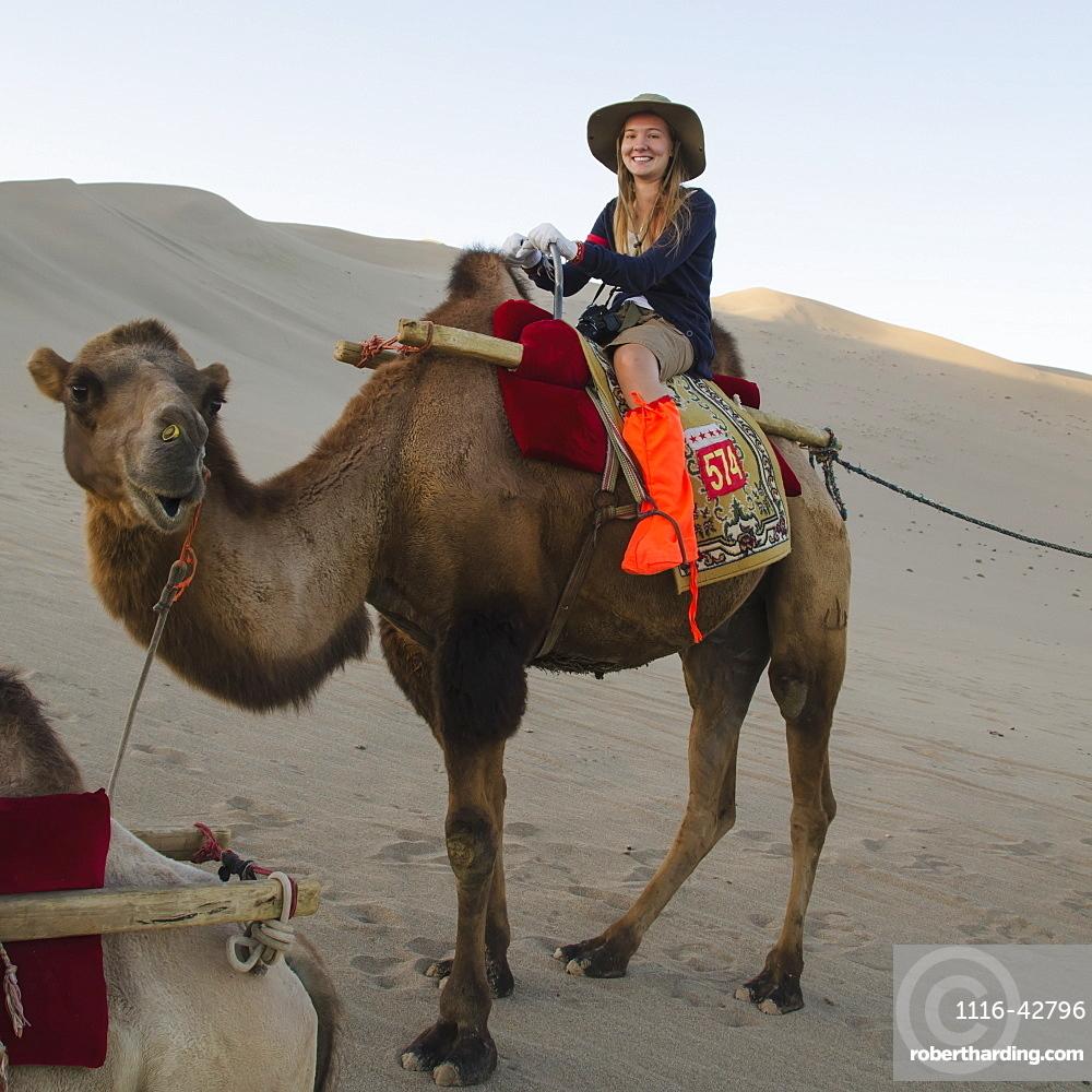 A girl riding a camel, Jiuquan gansu china