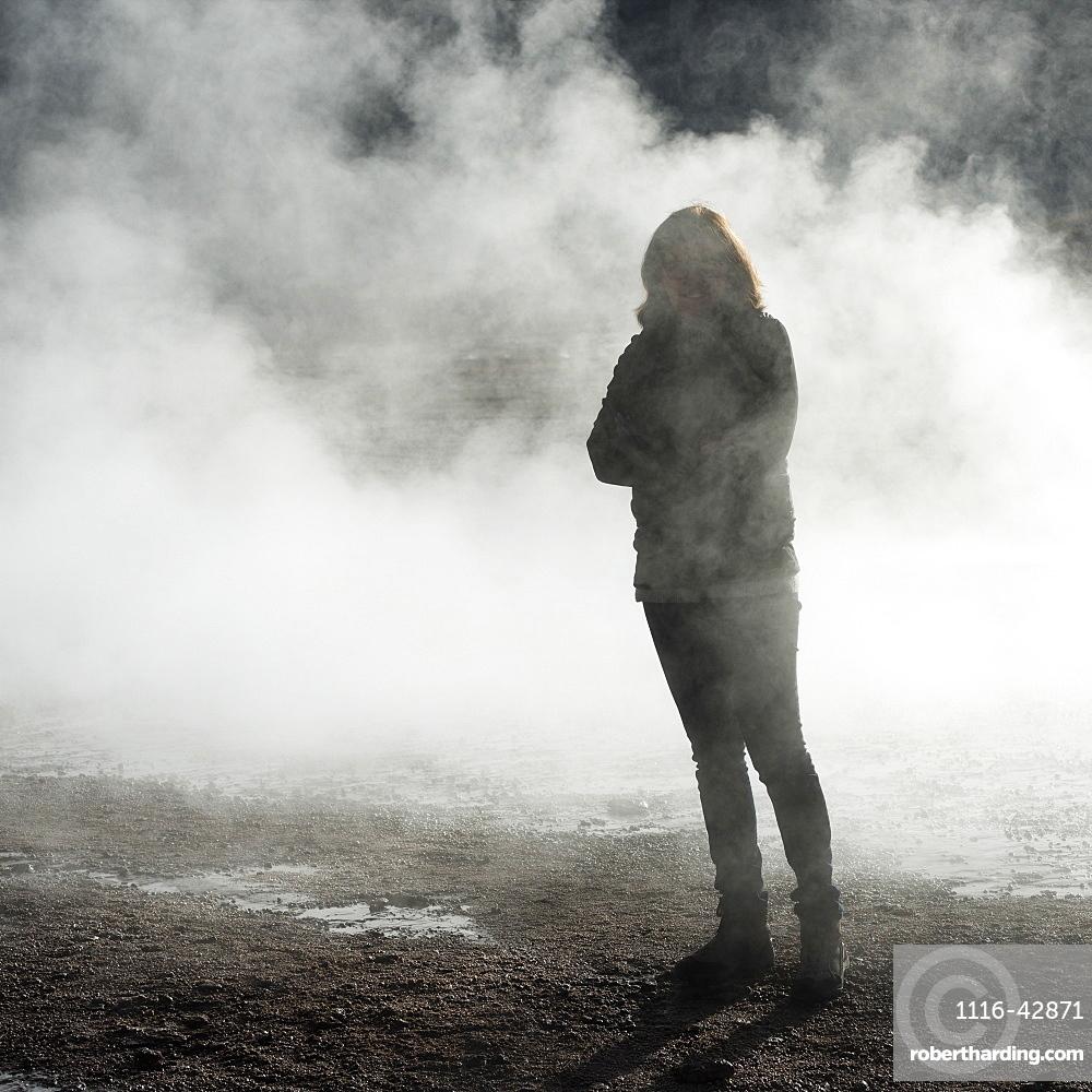 A Woman Stands In The Steam Of A Geyser, El Tatio Geysers, Calama, Antofagasta Region, Chile