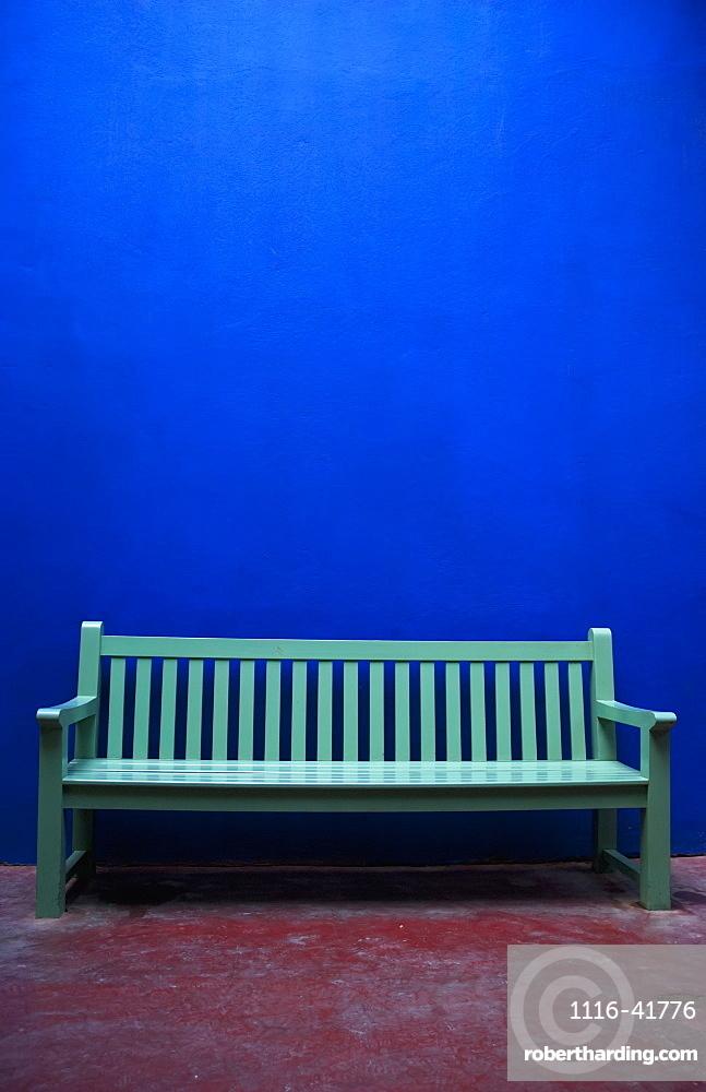 A painted green bench along a blue wall, Marrakech, morocco
