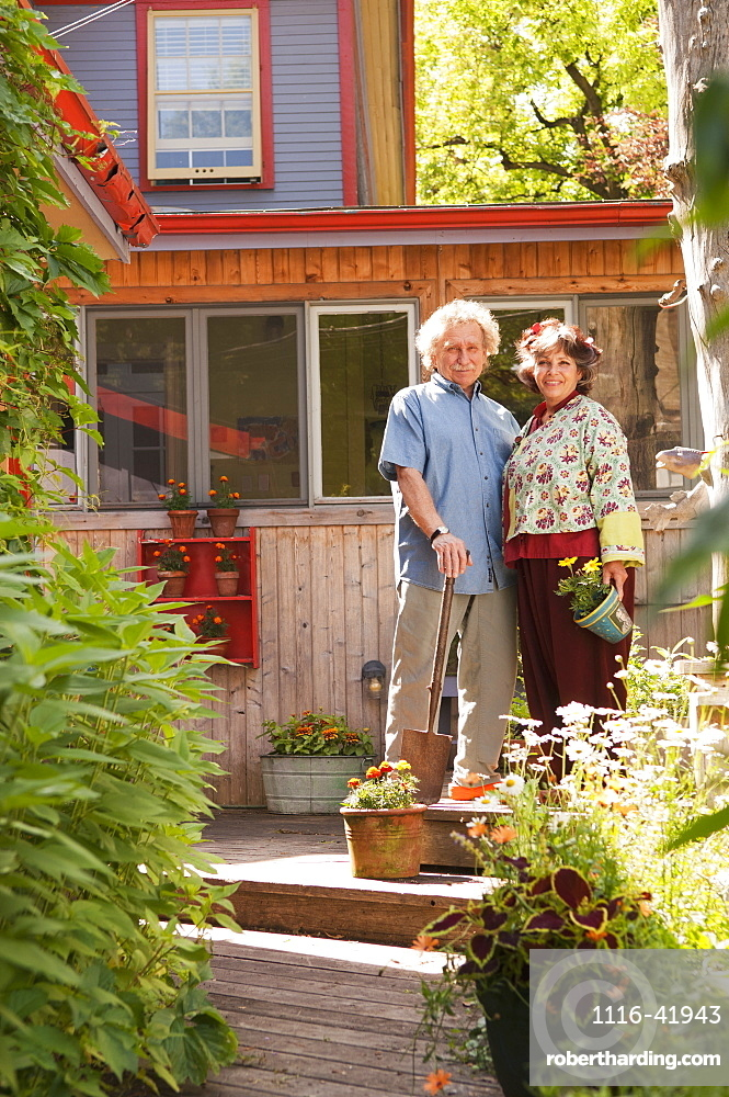 Senior Couple Standing In Their Home Garden, Winnipeg Manitoba Canada