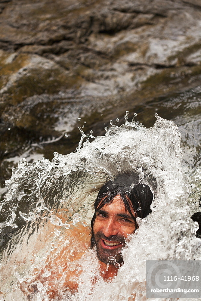 A man with water splashing over his head, Gold coast queensland australia