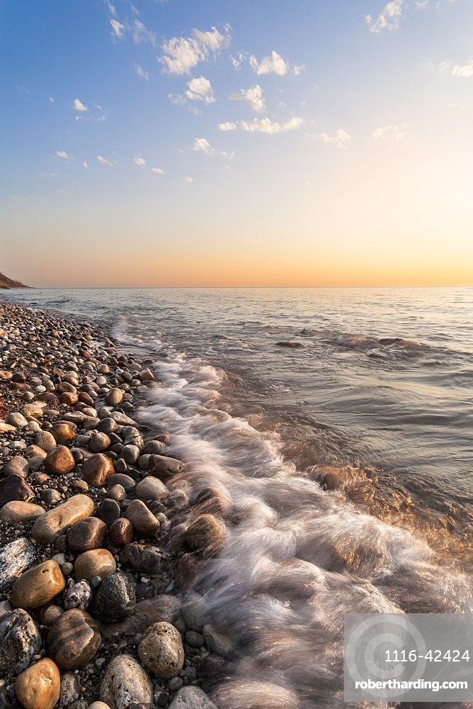 Waves Hitting The Rocks On The Shoreline Of Lake Michigan, Wisconsin, United States Of America