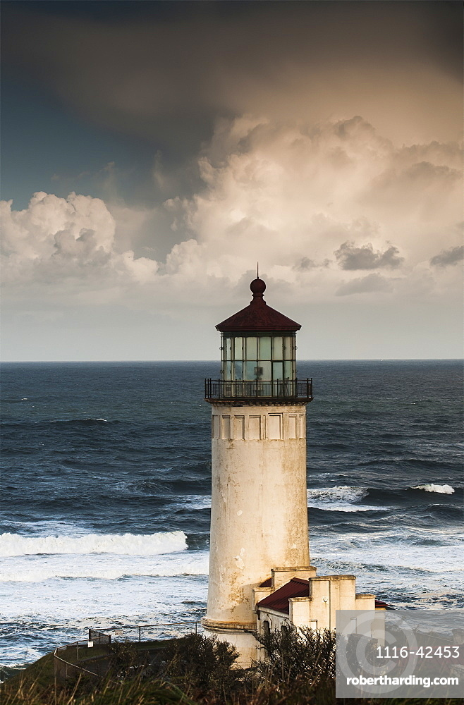 North Head Lighthouse Complemented By Clouds And Surf, Ilwaco, Washington, United States Of America