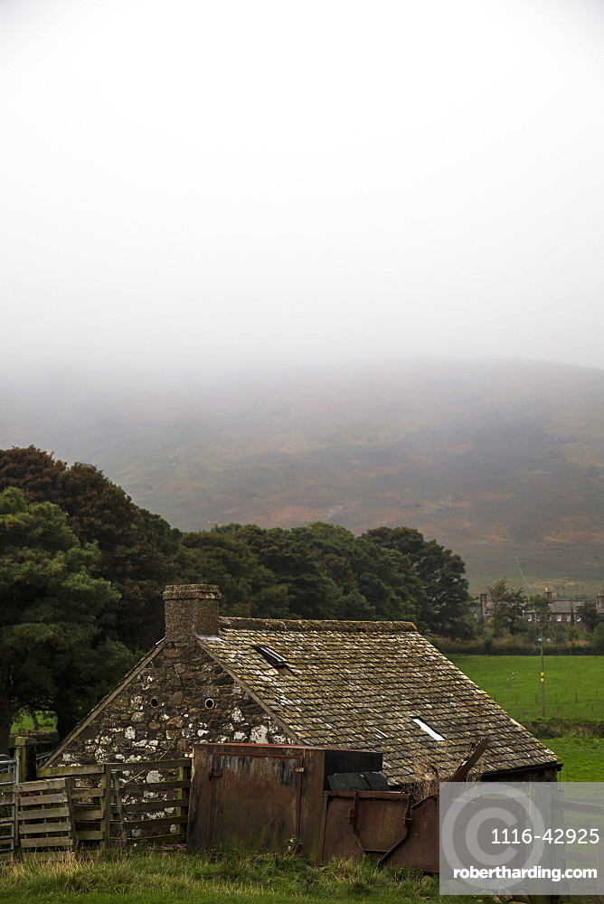 Dense Fog Over The Hills With A Small Stone House In The Foreground, Northumberland, England