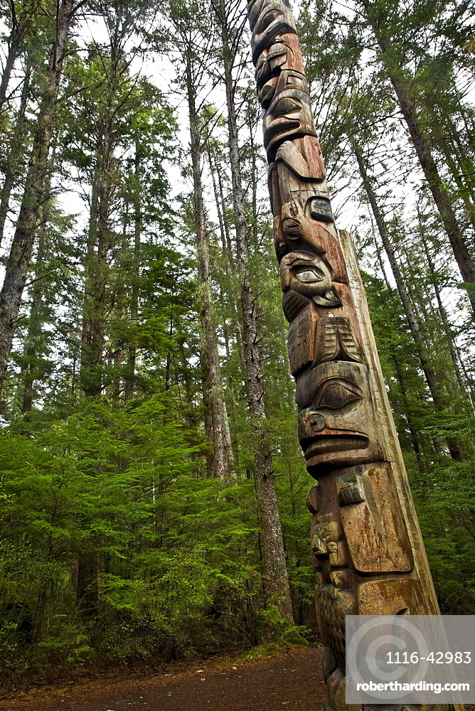 A Totem Pole Along The Totem Trail, Surrounded By Forest, Sitka National Historical Park, Sitka, Alaska, United States Of America