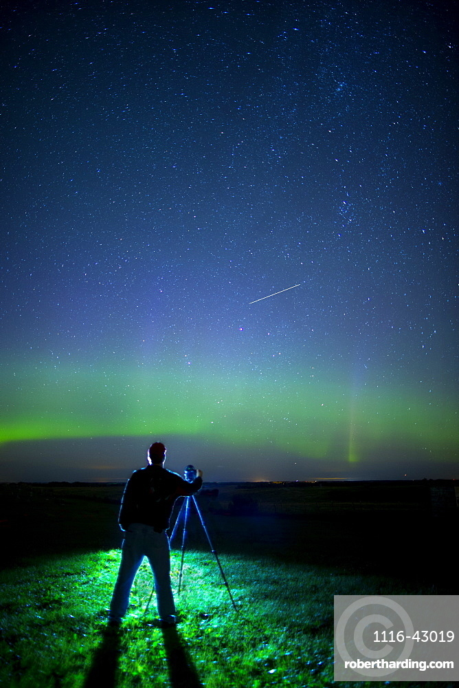 A Photographer Captures The Northern Lights And Shooting Star, Near Edmonton, Alberta Canada