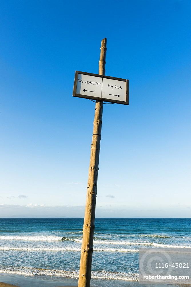 Sign On The Beach For Windsurfing And Bathrooms, Tarifa, Cadiz, Andalusia, Spain