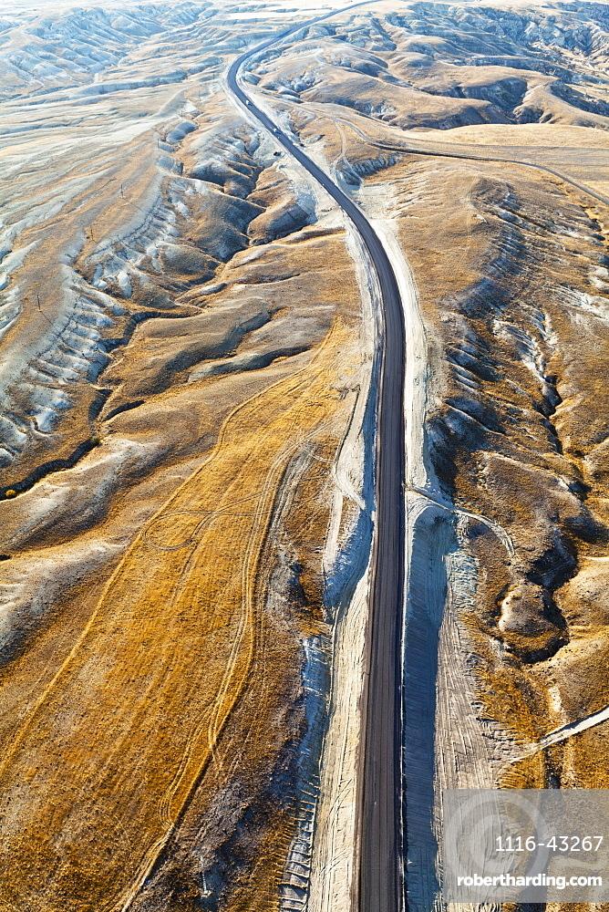 Aerial View Of A Road Through A Rugged, Barren Landscape, Cappadocia, Turkey