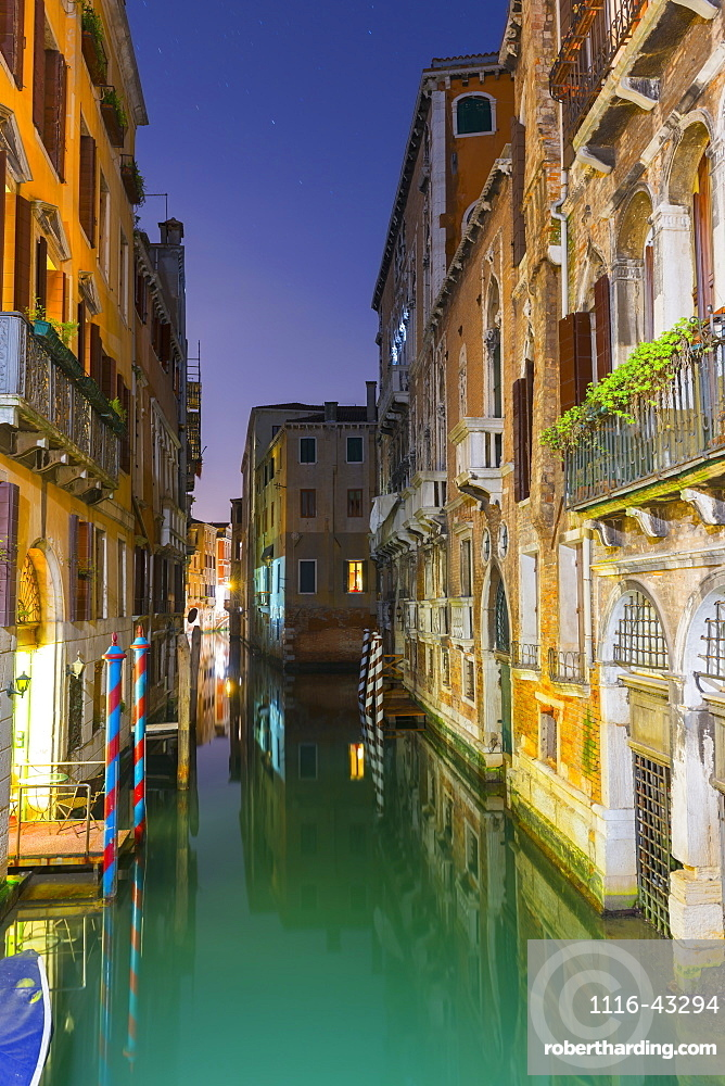 Turquoise Water In A Narrow Canal Between Buildings At Dusk, Venice, Veneto, Italy