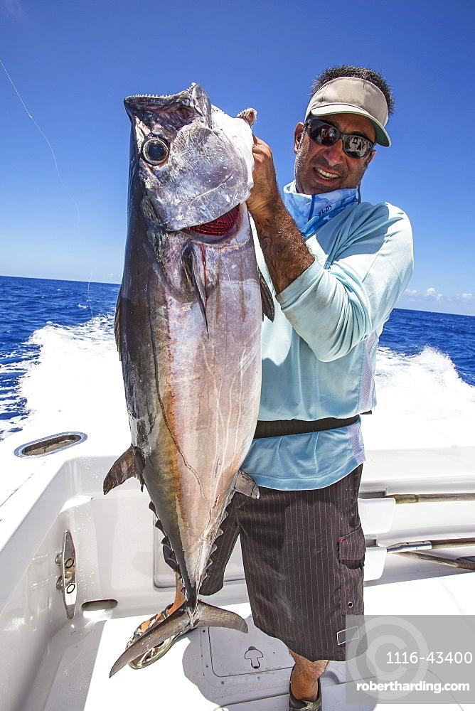 Fisherman Holding Dogtooth Tuna (Gymnosarda Unicolor), Tahiti