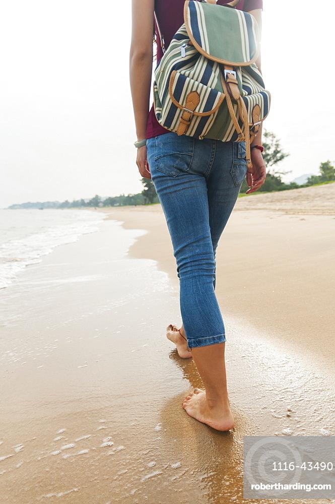 Chinese Girl Walking Along Xiamen's Beach, Xiamen, Fujian Province, China
