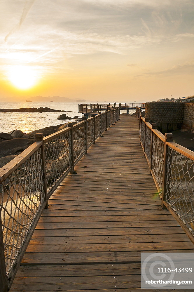 Wooden Boardwalk With Railing Along The Water, Xiamen, Fujian, China