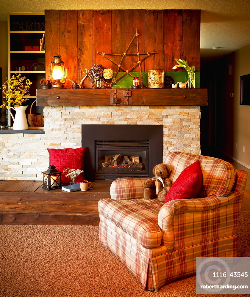 A Living Room Chair In Front Of The Fireplace, Yarrow, British Columbia, Canada