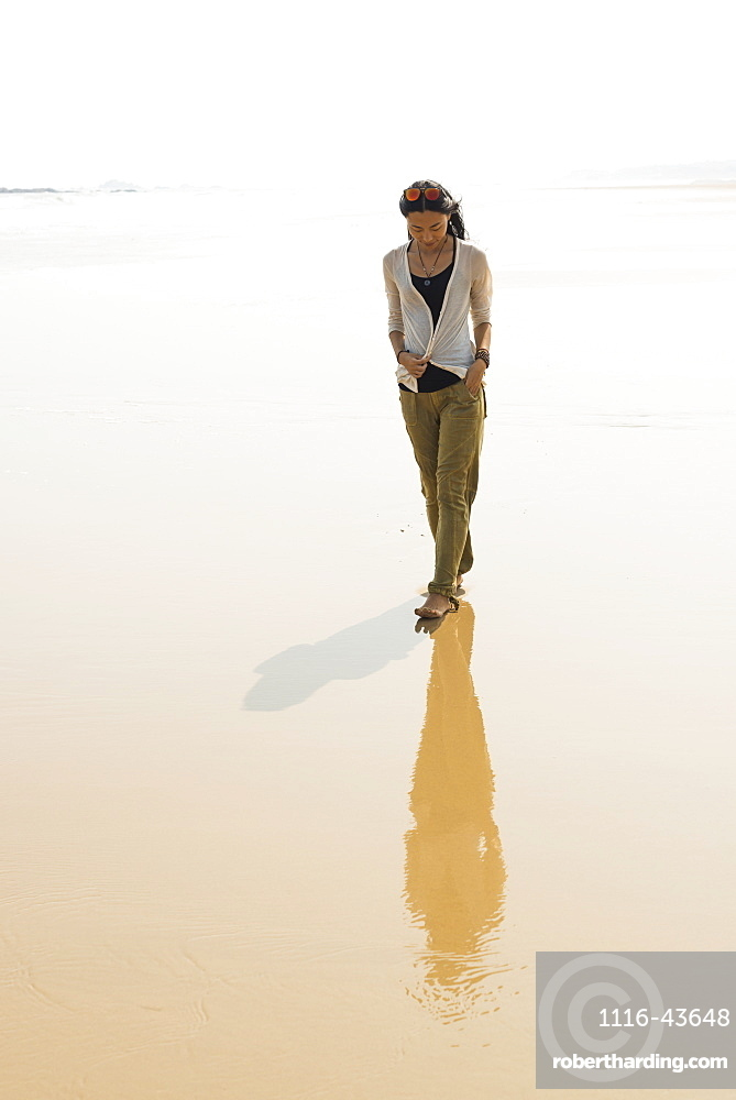 Young Woman Walking On The Beach From Huohu, North Of Kinmen Island, Taiwan