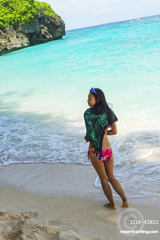 Young Woman Enjoys Walking On The Sand Of Puka Beach, Borakay, Panay, Philippines