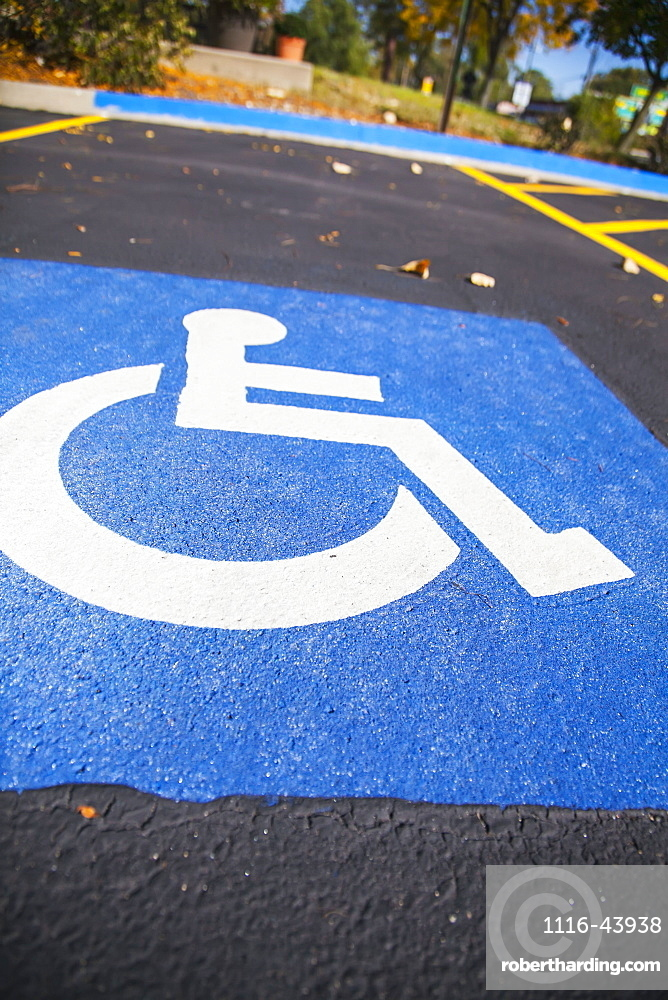 Handicap Symbol Painted In A Parking Lot Stall, Wheaton, Illinois, United States Of America
