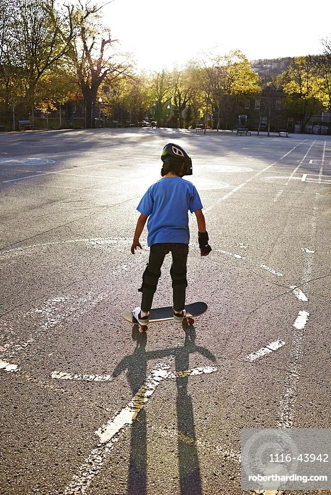 Young Boy Riding A Skateboard, Montreal, Quebec, Canada