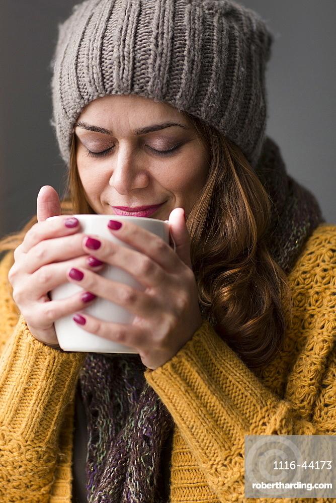 Nicaraguan Woman Drinking A Cup Of Tea, Toronto, Ontario, Canada