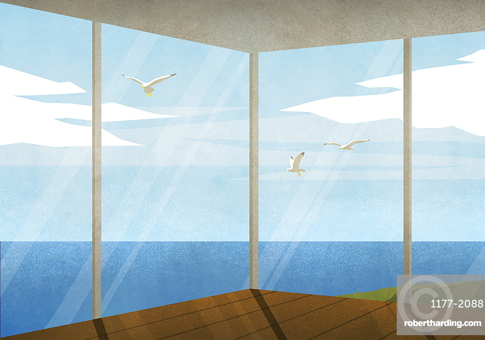 Seagulls flying outside beach house with ocean view