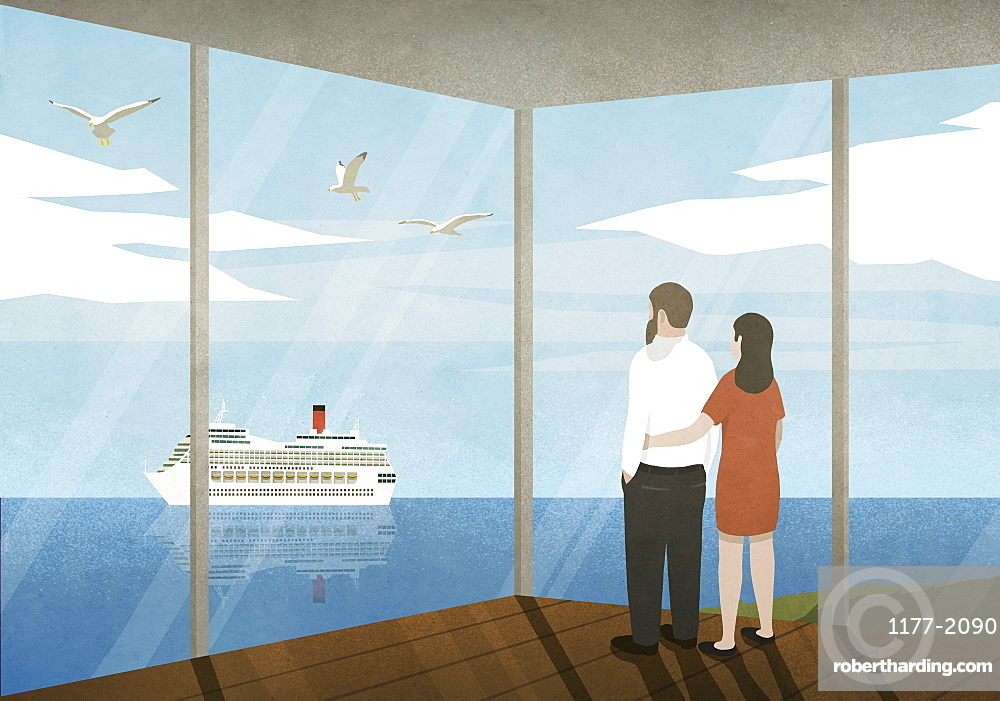 Couple watching cruise ship passing on ocean from beach house