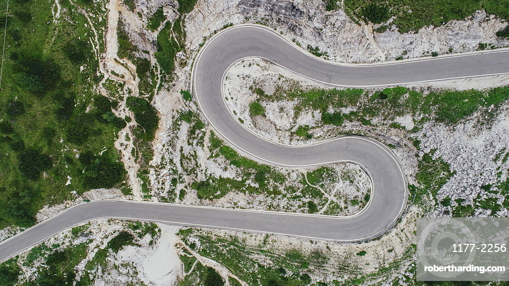 Aerial view road winding through Drei Zinnen Nature Park, South Tyrol, Italy
