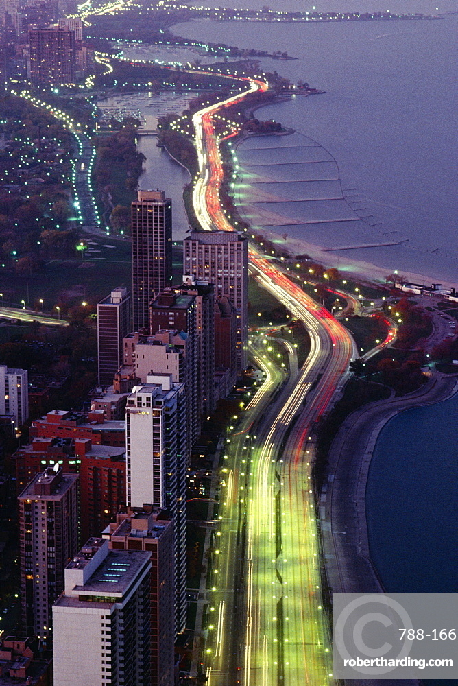 Aerial view of buildings along a highway in a city, Lake Michigan, Chicago, USA