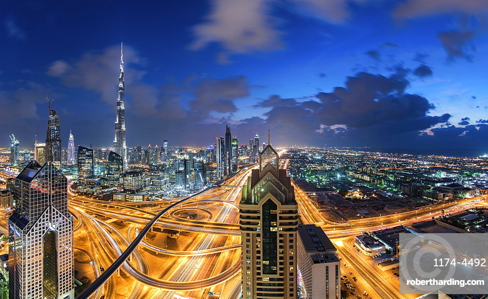 Cityscape of Dubai, United Arab Emirates at dusk, with the Burj Khalifa and other skyscrapers and illuminated highway in the centre, Dubai, United Arab Emirates