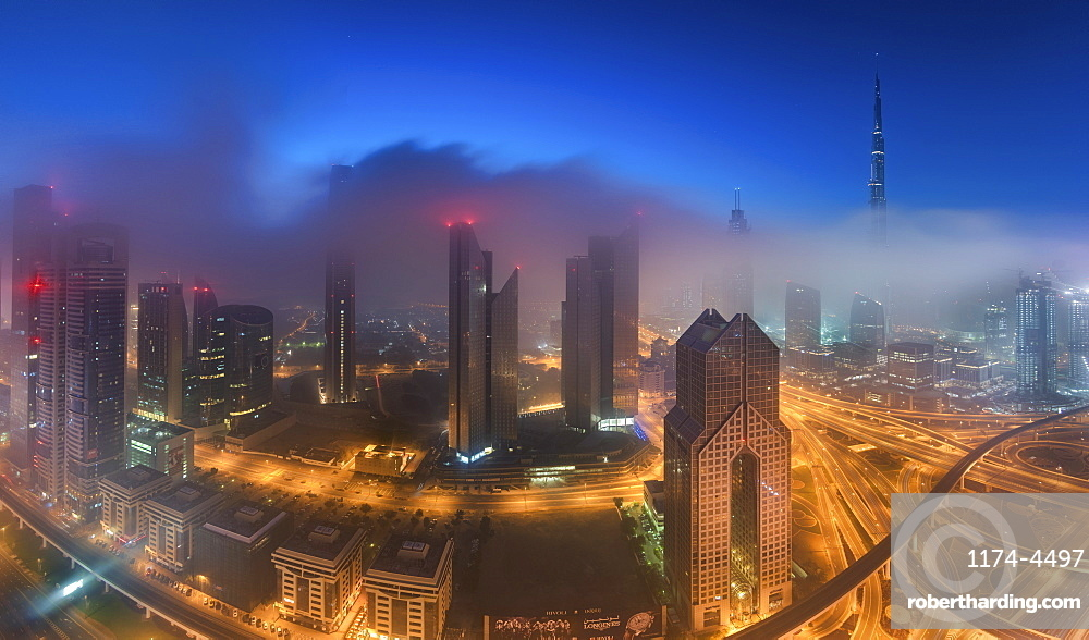 Cityscape with illuminated skyscrapers in Dubai, United Arab Emirates at dusk, Dubai, United Arab Emirates