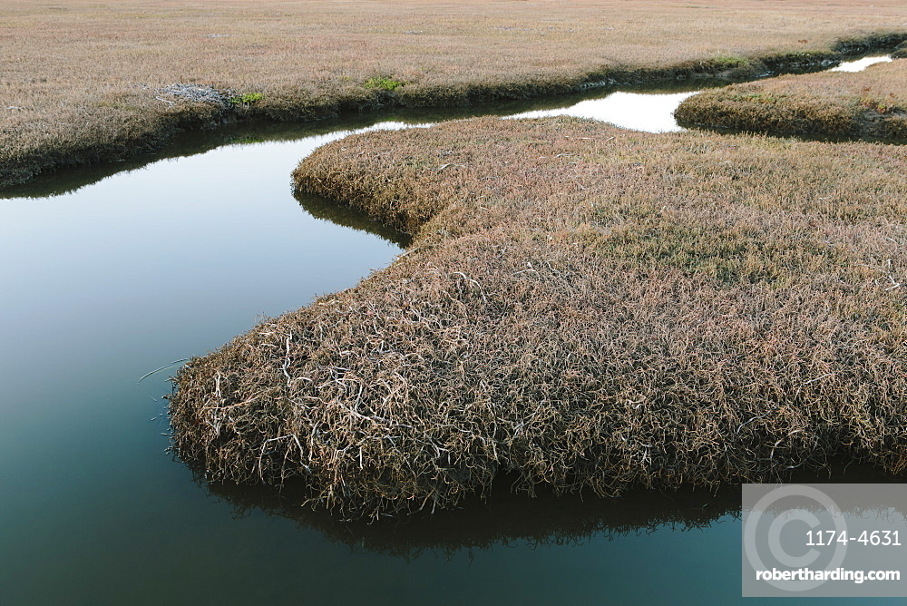 The open spaces of marshland and water channels. Flat calm water.