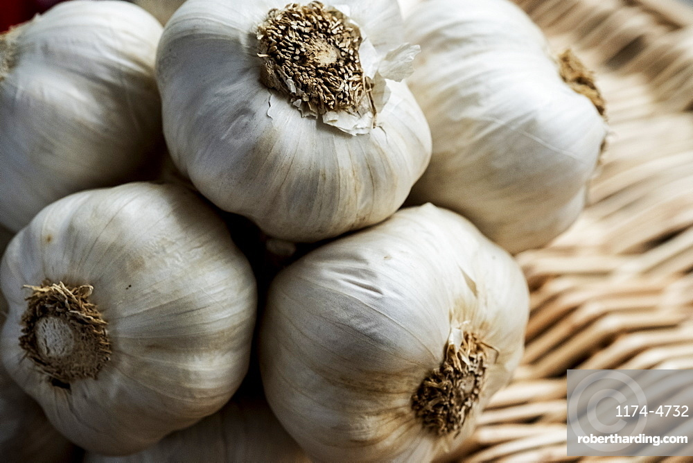 High angle view of a few garlic bulbs in a basket