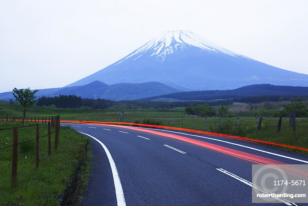 Blurred headlights on road before mountain, Japan, Japan