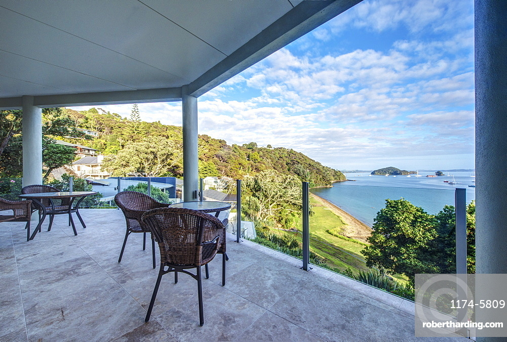 Table and chairs on balcony overlooking Bay of Islands, Paihia, New Zealand, Bay of Islands, Paihia, New Zealand