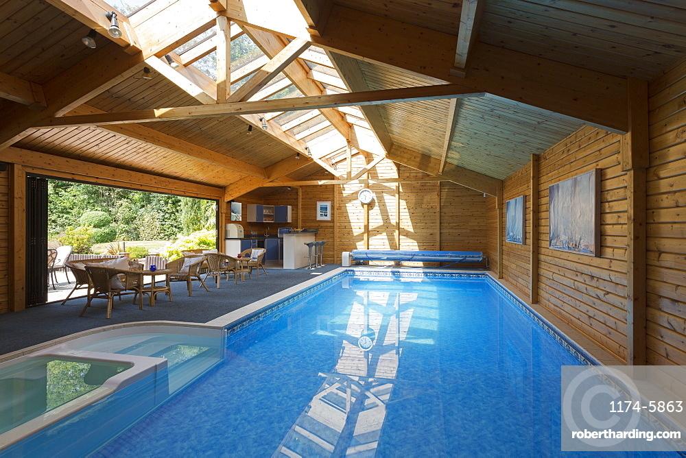 Indoor swimming pool under skylight, Farnham Royal, Buckinghamshire, UK