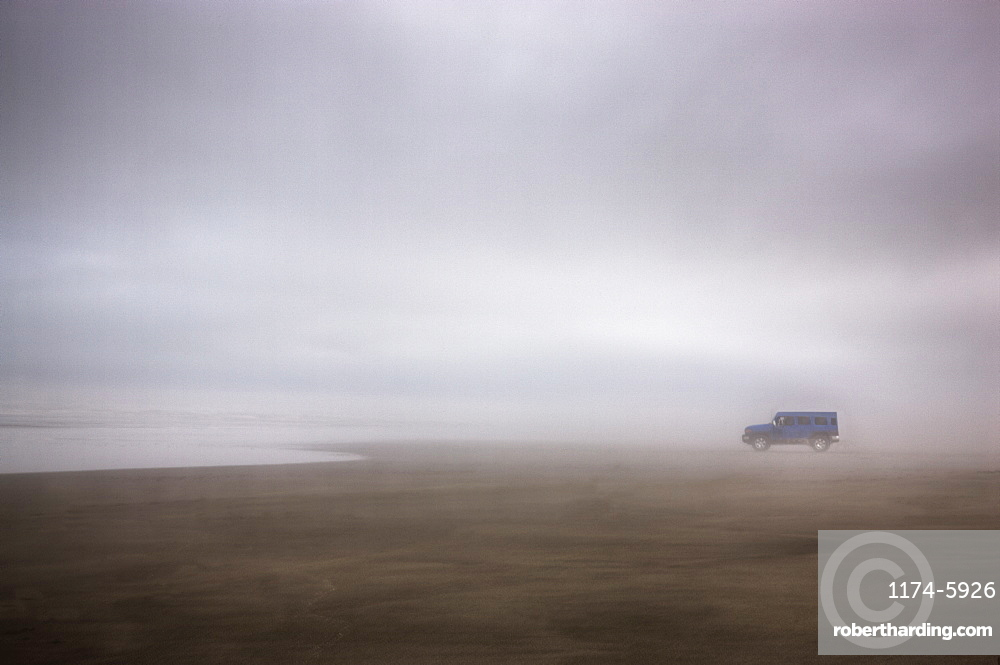Truck on foggy beach, Long Beach, Washington, USA