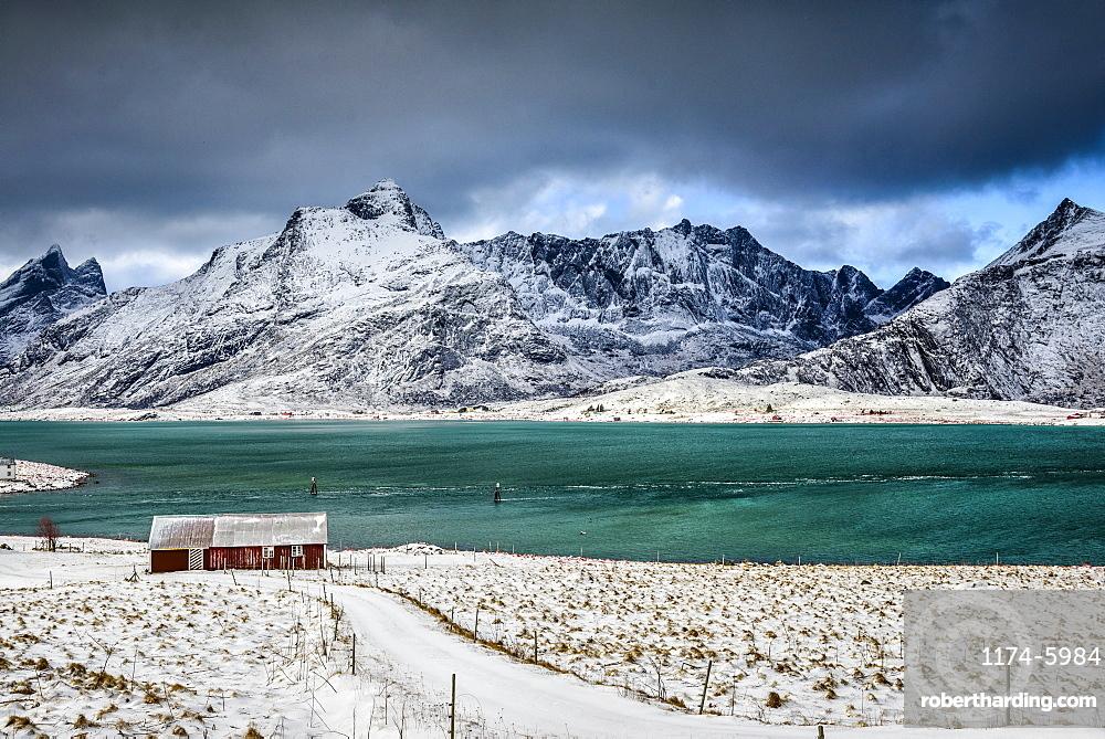 Snowy mountains overlooking ocean, Reine, Lofoten Islands, Norway