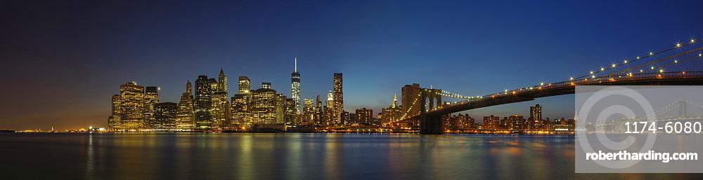 Panoramic view of New York city skyline illuminated at night, New York, United States