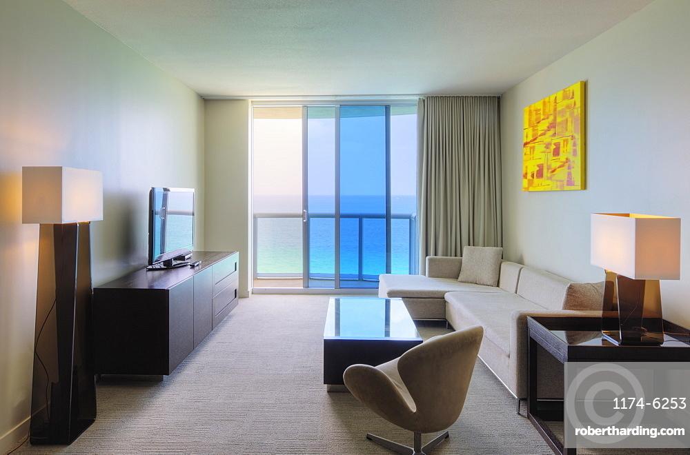Sofa and television in hotel room, Miami, Florida, USA
