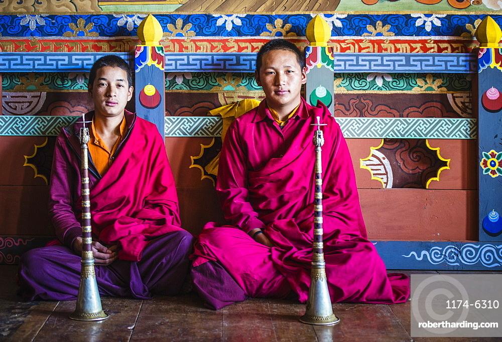 Asian monks sitting on temple floor, Bhutan, Kingdom of Bhutan