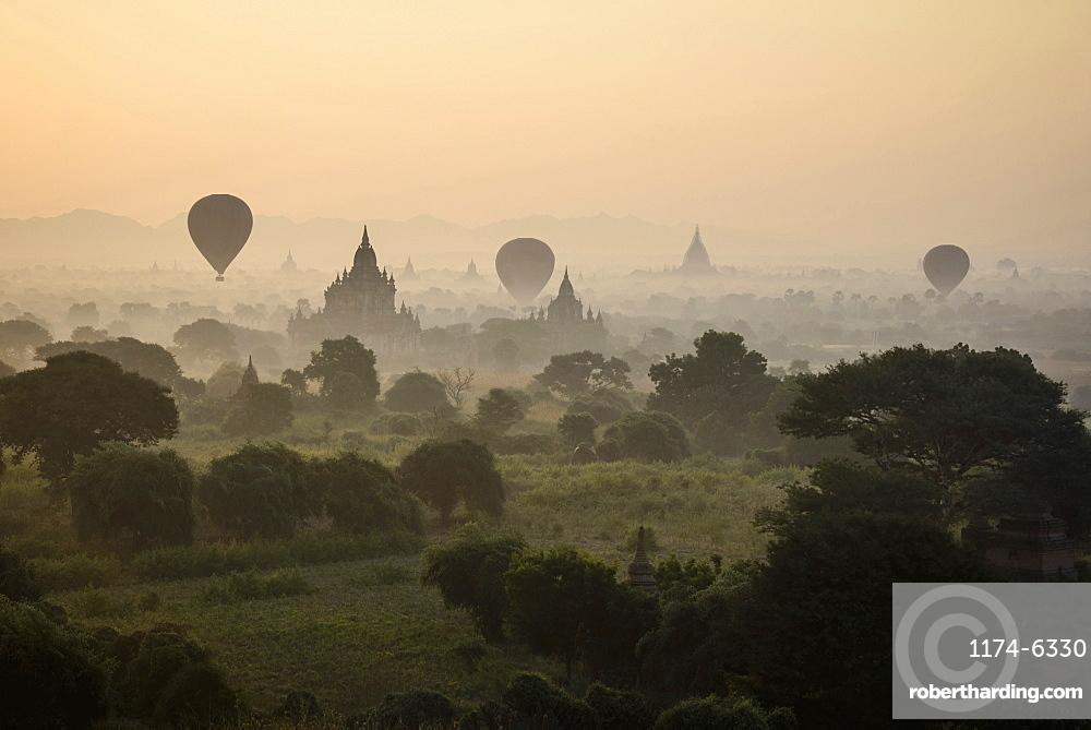 Hot air balloons flying over towers, Bagan, Myanmar