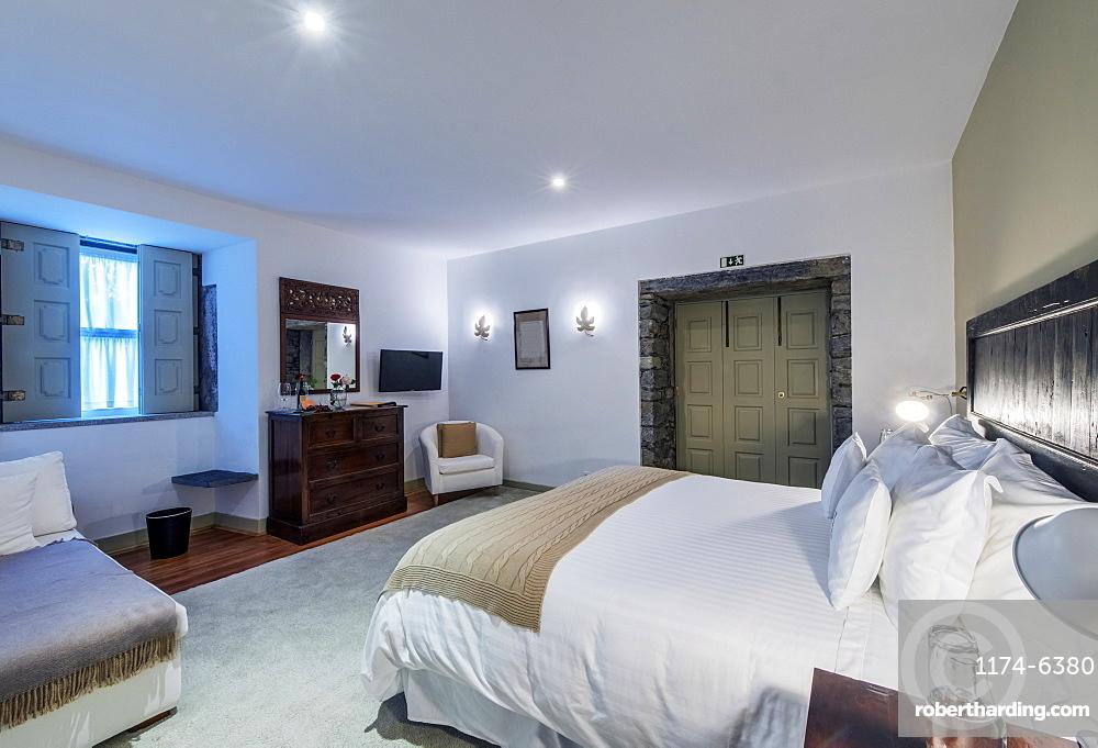 Bed and vanity in hotel room, Peso da Regua, Vila Real, Portugal