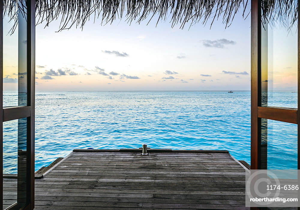 Wooden dock and ocean at sunset, Male, Maldives, Maldives