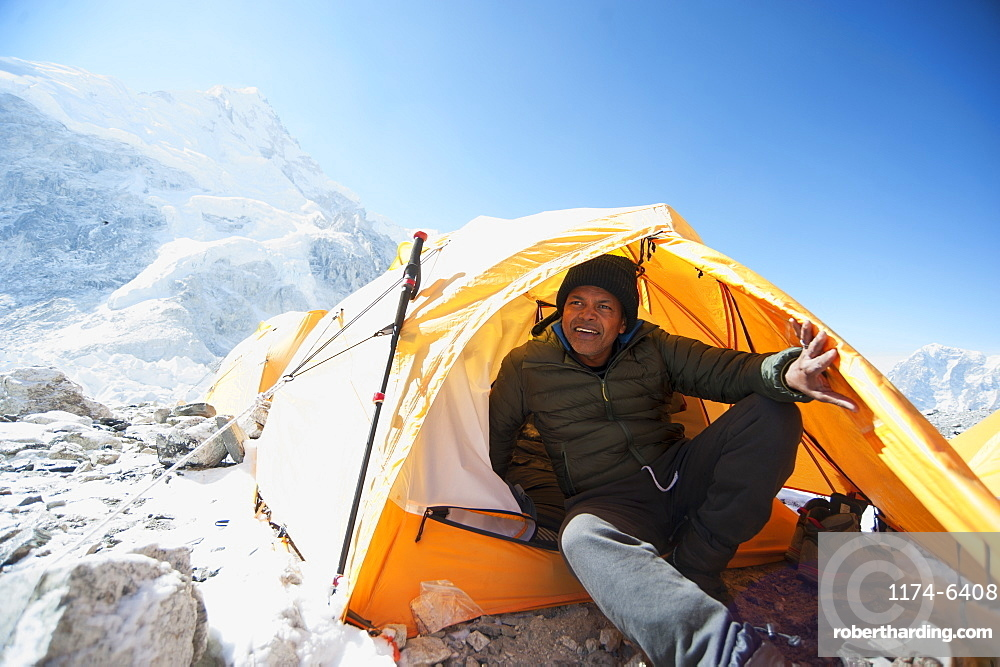 Man sitting in base camp tent, Everest, Khumbu glacier, Nepal, Everest, Khumbu glacier, Nepal