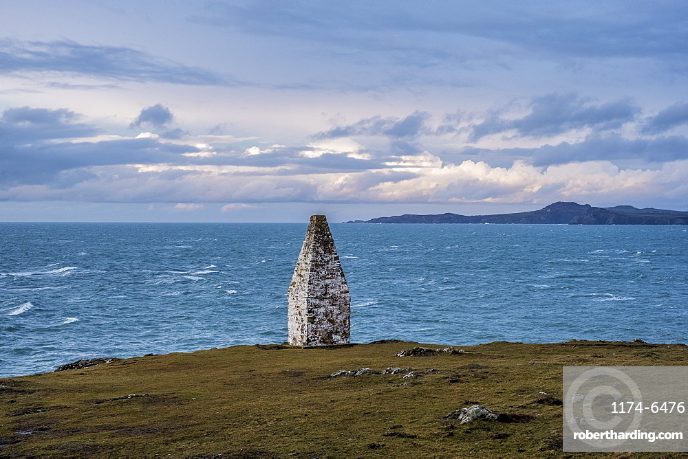 Cardigan Bay and stone cairn marking the entrance to Porthgain Harbour from the Pembrokeshire Coast Trail, Pembrokeshire National Park, Wales, UK, Pembrokeshire National Park, Wales