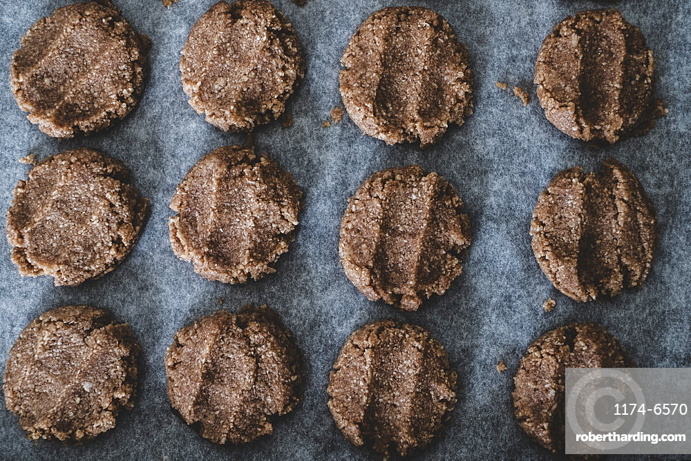 High angle close up of chocolate cookie dough on a baking tray, England