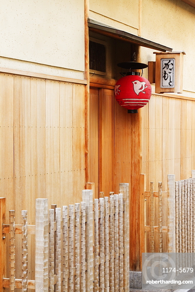 Red Asian Lamp Hanging Outside a Building Door, Kyoto, Japan
