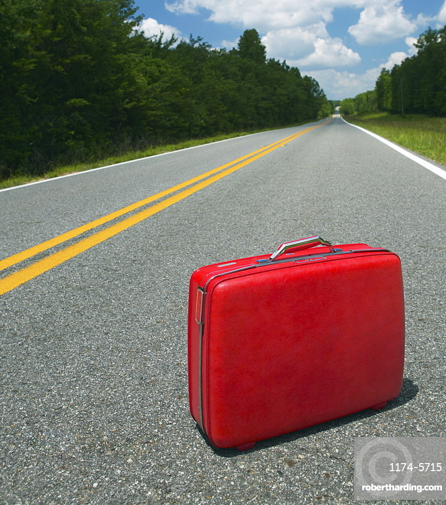 Red Suitcase Abandoned in Road, Georgia, USA