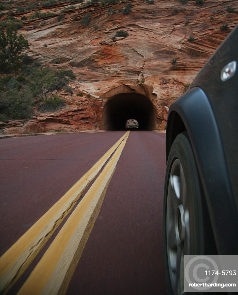 Car driving on rural road in Zion National Park, Utah, United States, Zion National Park, Utah, USA