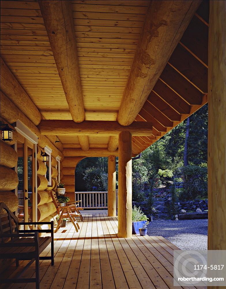 Log cabin porch, Vashon Island, Washington, USA