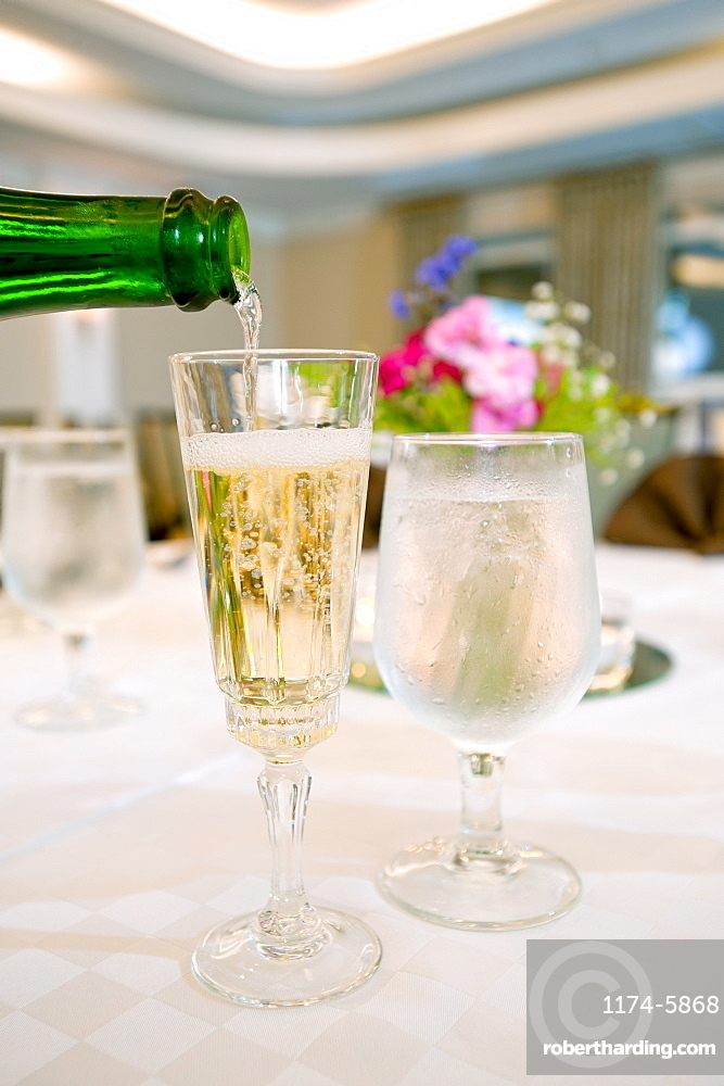 Glasses of champagne and water on table, Palm Beach, Florida, USA
